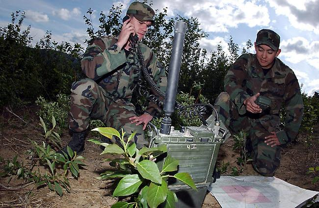 Airman uses a PRC-117 multiband tactical radio while fellow Airman uses a  PSN-13 defense advance GPS receiver Poster Print by Stocktrek Images