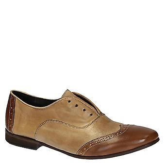 Handmade women's wingtip slip-on oxford shoes in leather