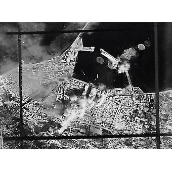 Aerial photograph showing direct bombing hits on a pierhead in Sousse Tunisia circa 1943 Poster Print by Stocktrek Images
