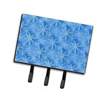 Akvarell mörkblå vinter snöflingor koppel eller nyckelhållare