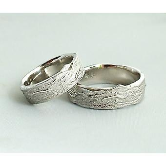Christian white gold matching wedding rings