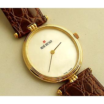 Golden Rene Becaud watch