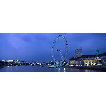 Ferris wheel at the waterfront Millennium Wheel London County Hall River Thames London England Poster Print