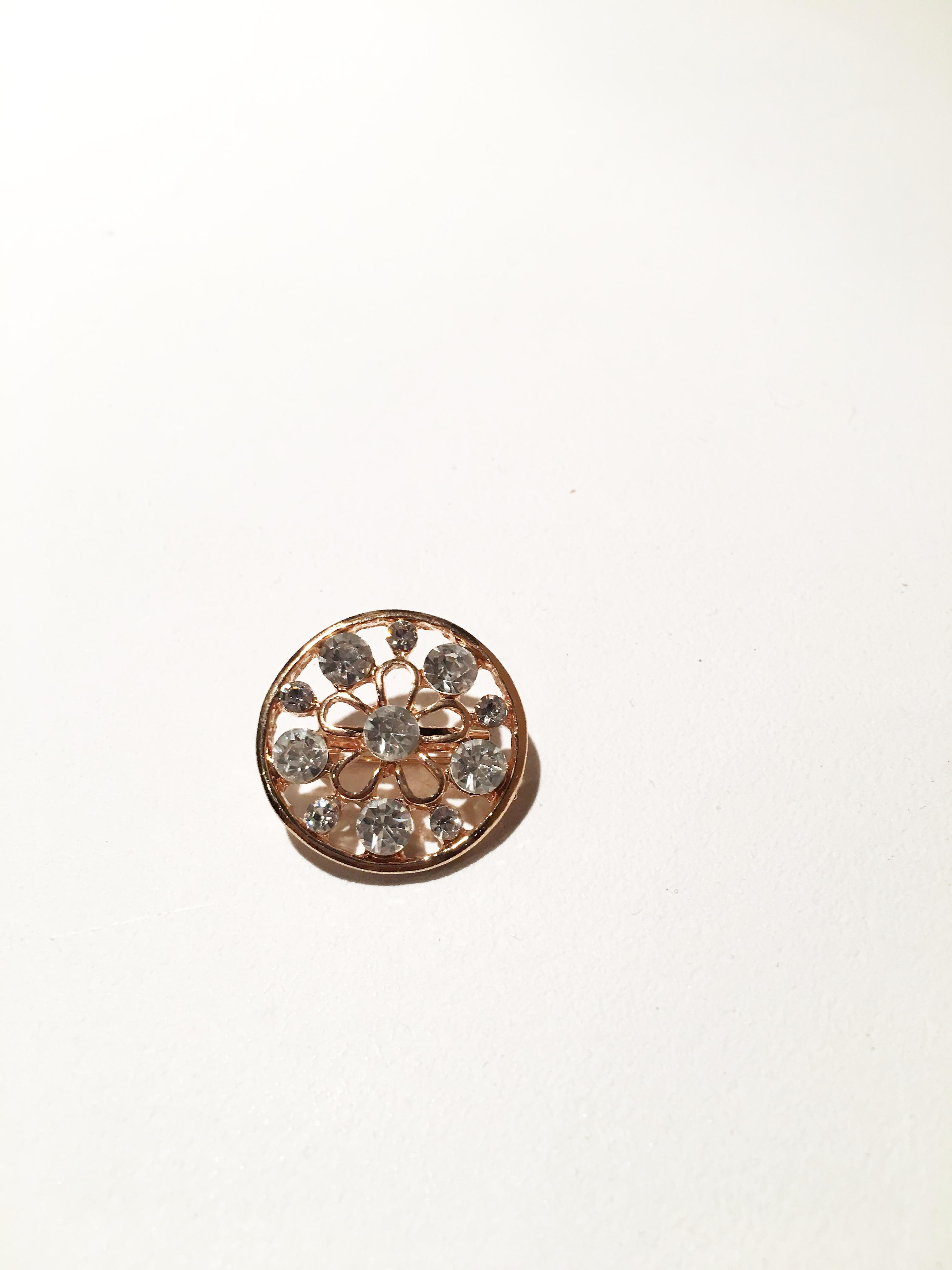 Antique gold and silver circular brooch