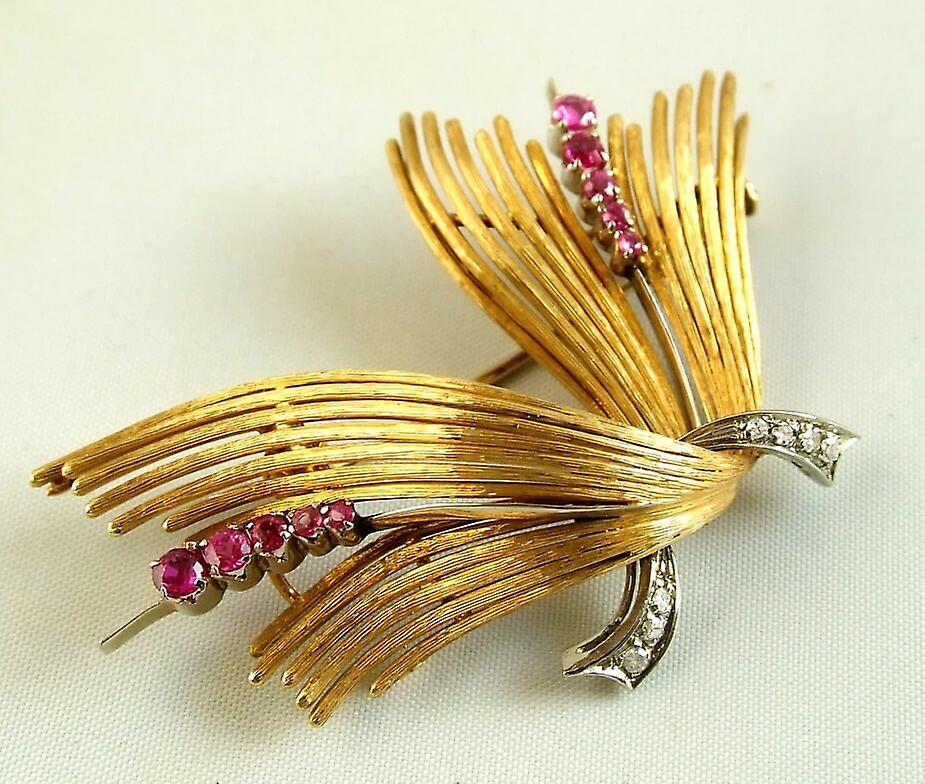 Gold brooch with diamonds and rubies