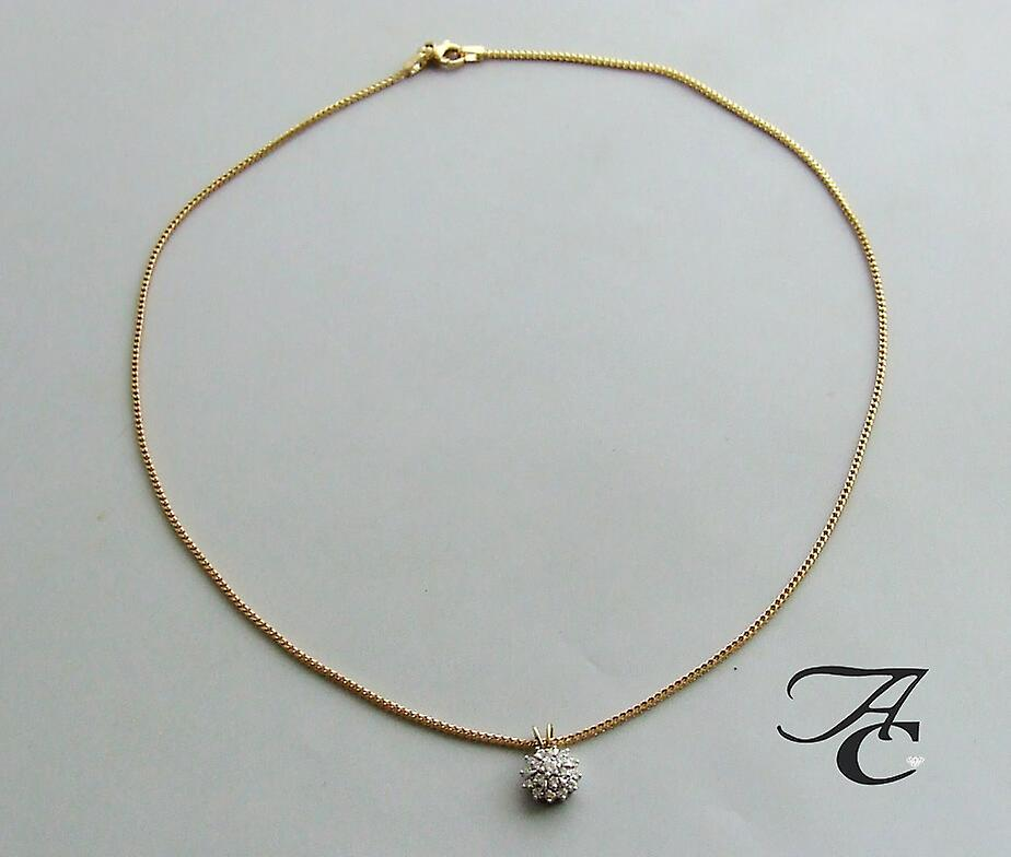 Gold necklace and pendant with diamonds