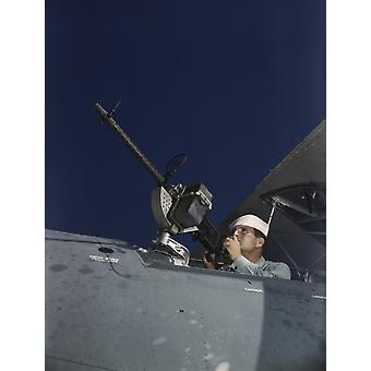 Sailor tries out a 30-caliber machine gun on a Navy plane 1942 Poster Print by Stocktrek Images