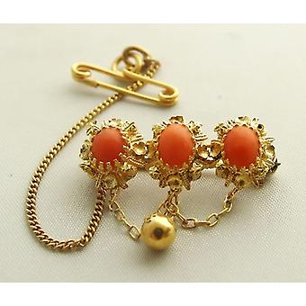 Gold brooch with red coral