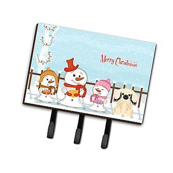 Caroline's Treasures Villancicos de Navidad Feliz Correa de crema de Pekín o titular de la llave Bb2437Th68, Triple