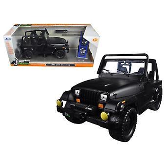 1992 Jeep Wrangler \Just Trucks\ With Extra Wheels Matt Black 1/24 Diecast Model Car By Jada