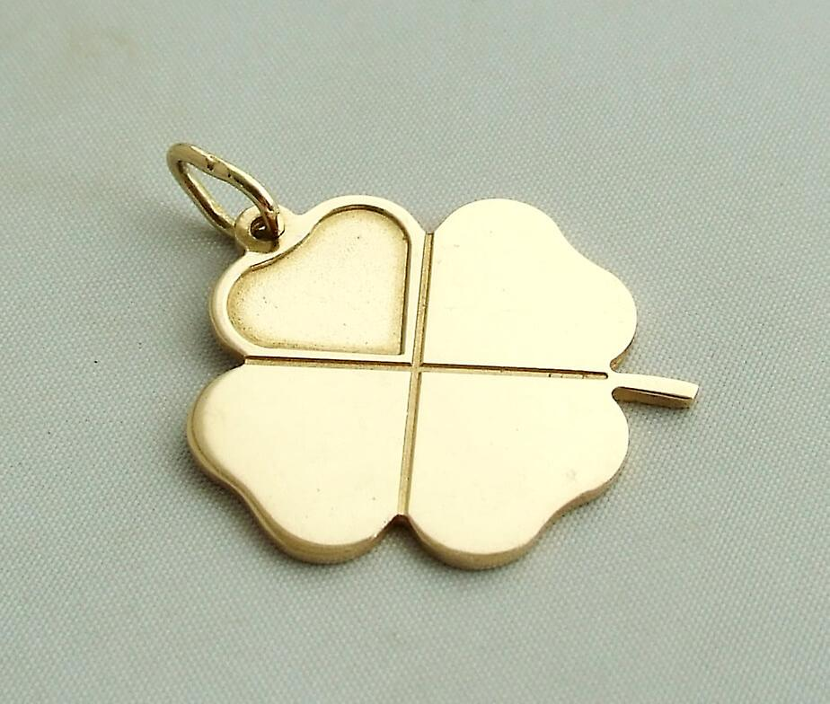 Gold four-leaf clover pendant