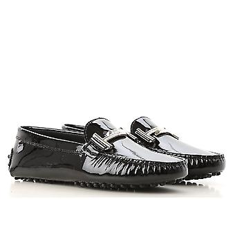Tod's women's moccasins in black Patent Leather with metal buckle