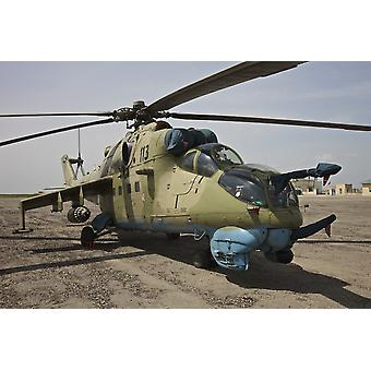 An Mi-35 attack helicopter operated by the Afghan National Army Air Corp at Kunduz Airfield Northern Afghanistan Poster Print
