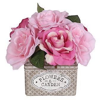 Lyserøde roser i dekorative firkantede Pot