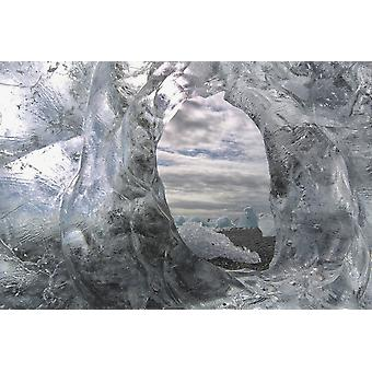 A hole in a coastal iceberg by the atlantic ocean with other icebergs seen through it iceland PosterPrint
