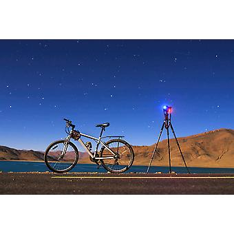 A camera tripod and bicycle on a full moon night at Yamdrok Lake Tibet China Poster Print by Jeff DaiStocktrek Images
