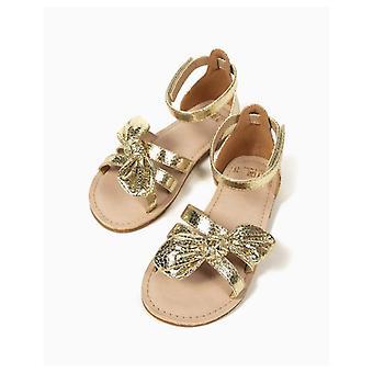 Zippy Golden Sandals