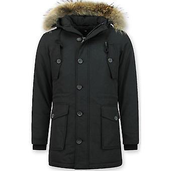 Long manteau d'hiver avec le grand collier de fourrure - Noir