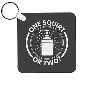 Yksi squirt tai kaksi saippua avaimenperä
