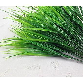 Artificial decorative grass plants