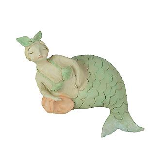 Whimsical Hand Painted Pastel Mermaid Leaning Against Fish Statue