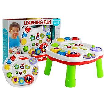 Leksaksbord med babyformer och musik
