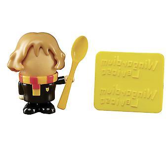 Harry Potter tasse d'oeufs et coupeur de pain Hermine Granger noir / jaune, 100% en plastique, dans l'emballage cadeau.