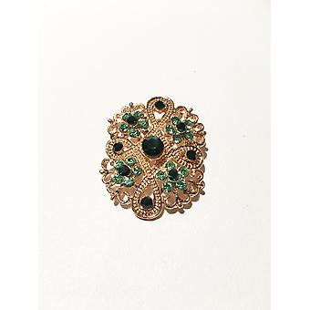 gold and emerald green brooch