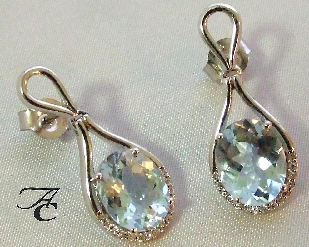 White gold earrings with aquamarine