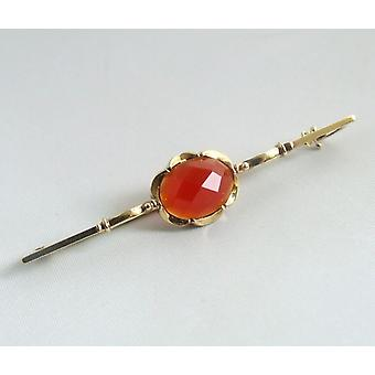 Gold brooch with Carnelian