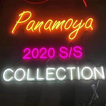 Neon lighted shop julkisivu nimikyltit