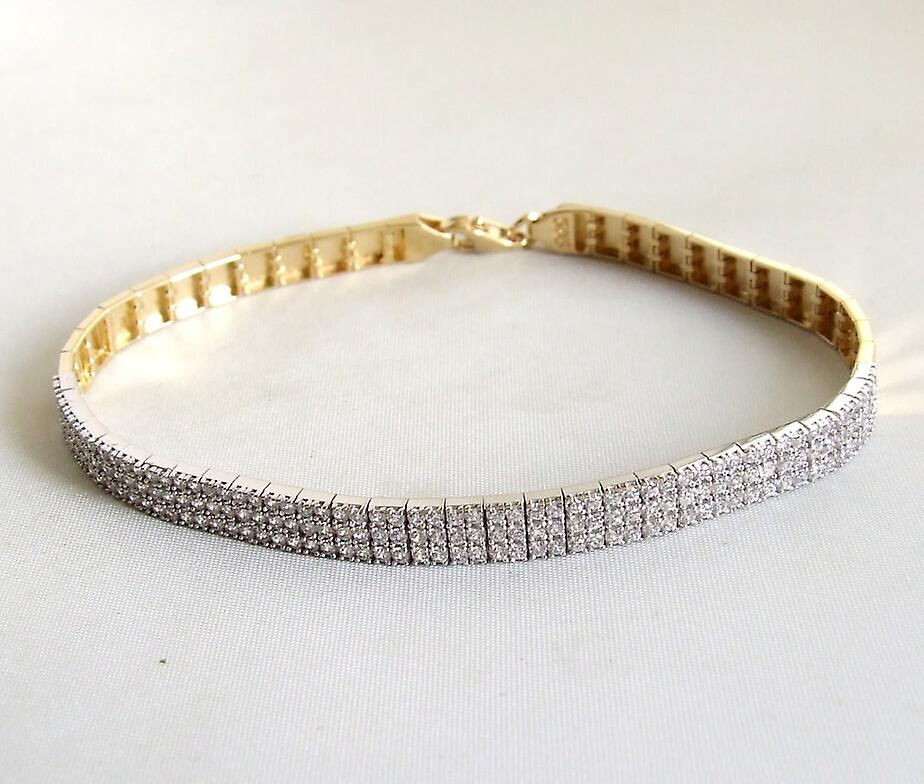 14 k Yellow and white gold bracelet with cubic zirconia