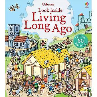 Look Inside Living Long Ago by Abigail Wheatley