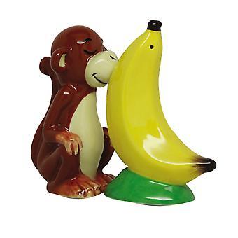 Kleine aap houdt een banaan zout en peper schudbeker Set