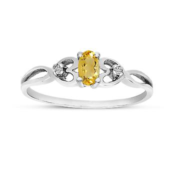 LXR 10k White Gold Oval Citrine and Diamond Ring 0.15 ct