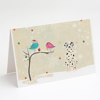 Regalos de Navidad entre tarjetas de felicitación dálmatas de amigos y paquete de sobres o