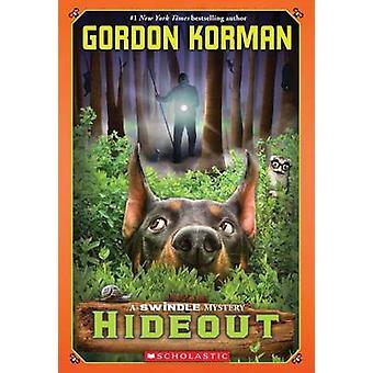 Hideout by Gordon Korman - 9780545448673 Book