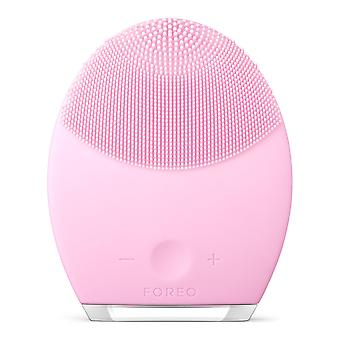 Foreo luna 2 facial brush and anti-aging face massager that gently removes dead skin cells and unclo