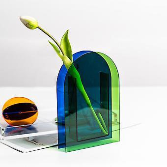 Sininen ja vihreä akryylimaljakko kuivalla kukka-astiakoristeella