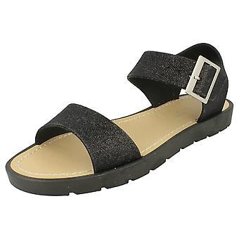 Las señoras brillan grueso sandalias de verano