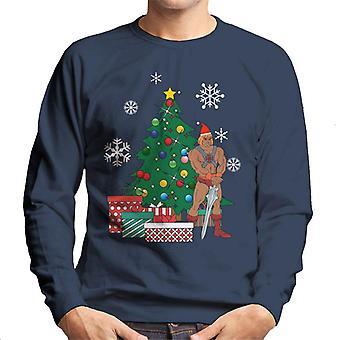 El hombre en sudadera el árbol de Navidad los hombres