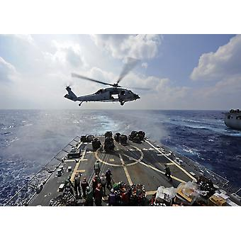 An MH-60R Sea Hawk transfers supplies to the flight deck of USS Wayne E Meyer Poster Print