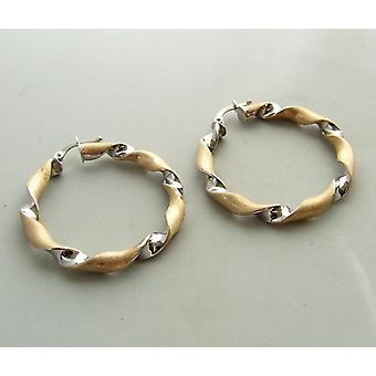 14 carat bicolor gold twisted earrings