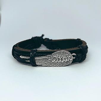 Bracelet fait main dans le cuir noir avec l'aile d'ange