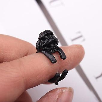Ring with dog hugging finger poodle black