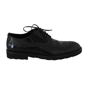 דולצ'ה וגבאנה שמלת עור שחורה דרבי כנף נעליים