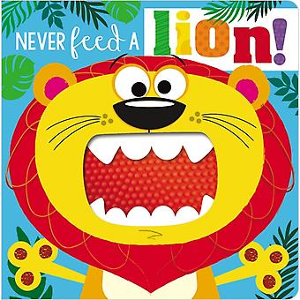 Never Feed a Lion by Ltd Make Believe Ideas & Rosie Greening & Illustrated by Stuart Lynch