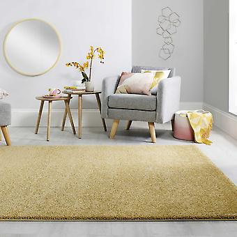 Slanke zachte ruige effen tapijten in gouden okergeel