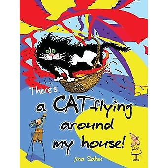 Theres a cat flying around my house by Sahm & jina Marion