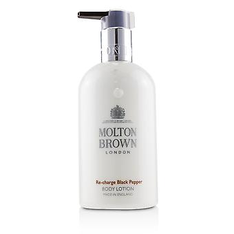 Re charge black pepper body lotion 231086 300ml/10oz